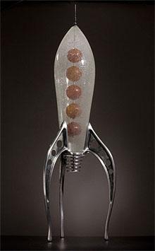 retro rocket sculpture by rik allen